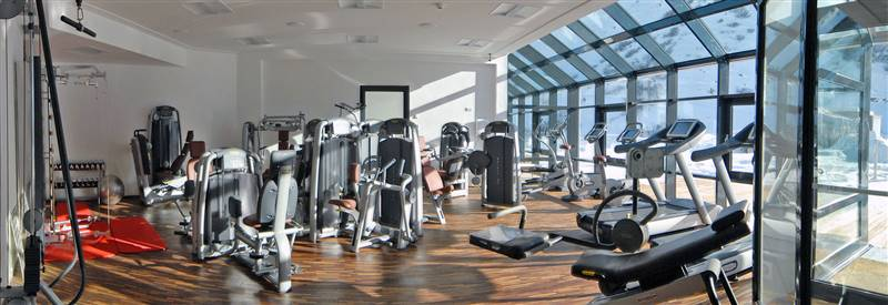 Fitness room for indoor sport in the holidays s hotel alpina